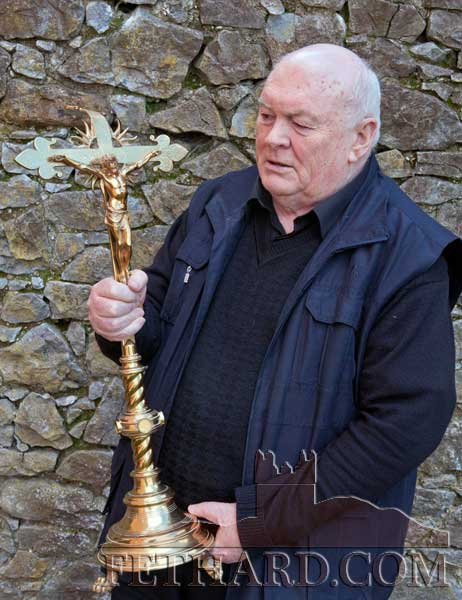 Fr. Martin Crean OSA, Prior, photographed with the crucifix used as a sledgehammer in the break-in at the Augustinian Abbey in Fethard last weekend.