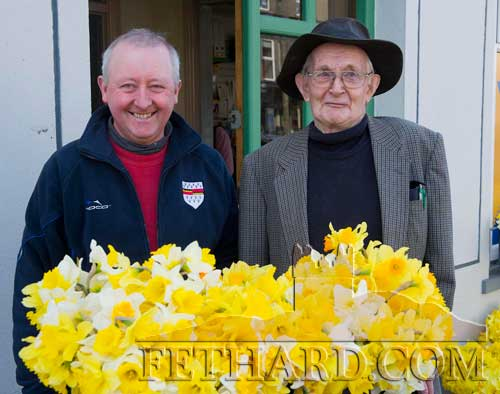 L to R: John Morrissey and Denis McGrath buying daffodils in Fethard on Daffodil Day.