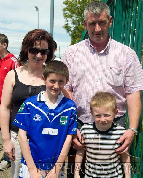 Ann and Shay Coen, Killusty, Fethard, with their two sons, Ben (left) and Jake, photographed at the Community Games County Athletics Finals in Templemore