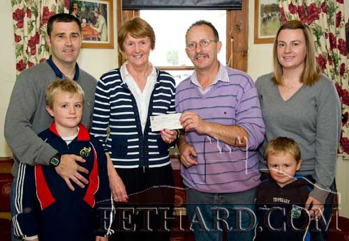 Noel Sharpe, proprietor Castle Inn, Fethard, presenting a cheque for €580, proceeds of a recent fundraising music night, to Eileen McEvoy representing CARE (Cancer Aftercare Relaxation Education) services in Wellington Street, Clonmel. L to R: Eugene Walsh with his son Ryan, Eileen McEvoy (CARE), Noel Sharpe (Castle Inn), Tracy Walsh with her son Charlie. Eugene is currently in training to take part in the Dublin City Marathon on October 31, to raise funds for CARE.