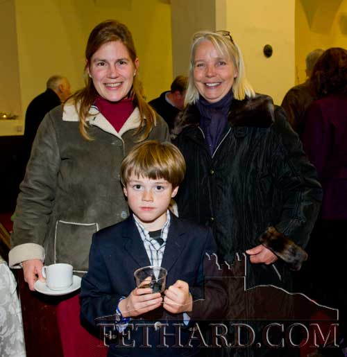 Photographed at the Christmas Carol Service at Holy Trinity Church of Ireland are L to R: Nicola Everard, Marion Goodbody and in front Jake ffrench Davis
