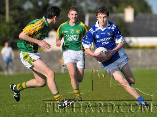 David Hayes gets past Toomevara's  Cathal Kennedy and Willie Coffey to launch another attack for Fethard in the U16 B County Final.