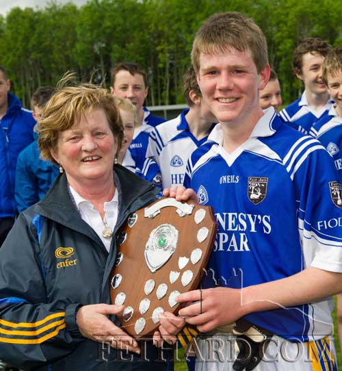 Brian Healy accepts the Danagher Shield from Mary Godfrey after Fethard won the Under 16B South Football Final. The match against Killenaule was played on Sunday, May 15, 2011, and finished with a scoreline of 4-17 to 2-7. (Photo: Kieran Butler)