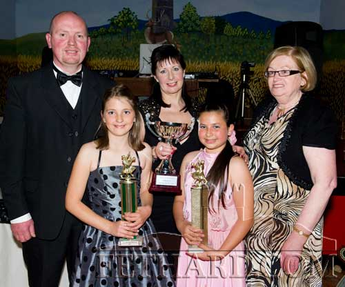 Overall winners (front) Courtney Walsh and Róisín McDonnell receiving their trophies from judges L to R: Pat Casey, Marina Mullins and Mary Delaney, at the Holy Trinity National School ballroom dancing exhibition held in Fethard Ballroom