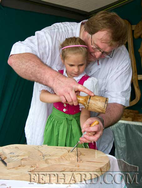 Julia Lanzinger, Clonmel, having a lesson in woodcarving from local craftsman, David Gorey, at the Fethard Medieval Festival