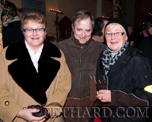 Photographed at the Candlelight Servica at Magorban Church are L to R: Bernie O'Meara, David O'Meara and Eileen Ryan