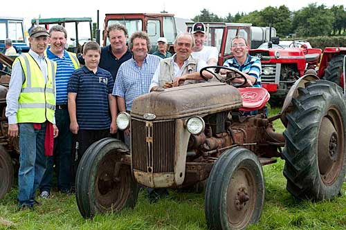 At Moyglass Vintage Day are L to R: Seamus Barry, Sean O'Donovan, Tim Daly, Liam Daly, Matty Tynan, Tom McCarthy (tractor owner), Eamon Barry and Tom Barry photographed beside 1950 Ford 8N tractor. Tom's father, Daniel T. McCarthy, Garryvale, Co. Cork, purchased the tractor new in 1950