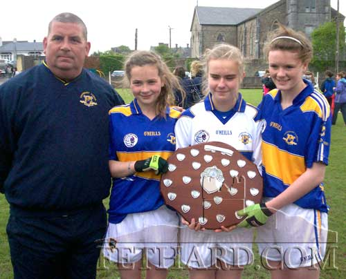 Selector Tom McCarthy photographed with Ciara Tillyer, Jessie McCarthy and Katie Butler who were members of the Tipperary U14 squad that defeated Waterford in the Munster U14 ladies football final.