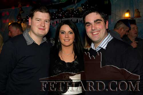 Enjoying New Year's Eve in Lonergans Bar, Fethard, are L to R: Donal Marah, Evelyn O'Connor and Ian O'Connor