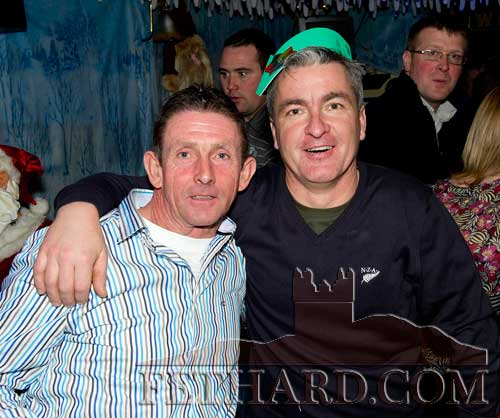 Enjoying New Year's Eve in Lonergans Bar, Fethard, are L to R: Lar Whyte and John Ryan