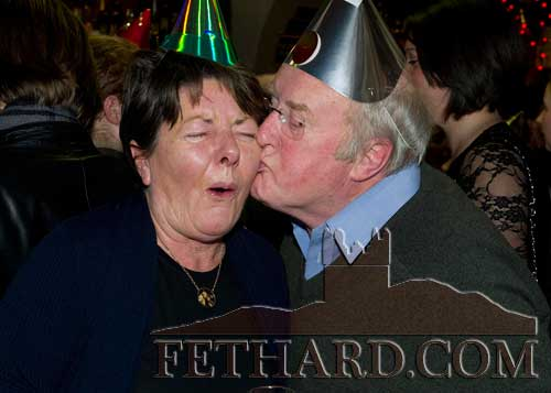 'Happy New Year', Bill O'Sullivan gives Annette Murphy a New Years kiss at McCarthy's Bar, Fethard