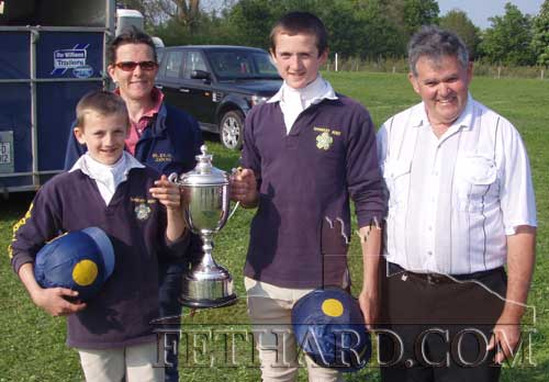 The Tom O'Connor & Eugene Martin Perpetual Challenge Cup was won recently by Harvey and Pierce Blackmore at the National Pony Club Huntertrial Championships in Crecora, Limerick. Photographed L to R: Pierce Blackmore, Anne Croome-Carroll (Tipperary Pony Club Trainer), Harvey Blackmore and Pat Walsh (Tipperary Pony Club District Commissioner).