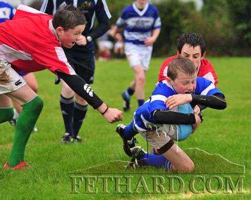 Fethard's Gary Kavanagh dives over the line to score a try in the Under 15 challenge against Cashel at the Community Sportsfield on Sunday, September 25. Training has resumed at the Rugby Club on Friday nights at 6.45pm for ages up to 13, and at 8pm for older players. Membership is being collected at training. (photo Kieran Butler)