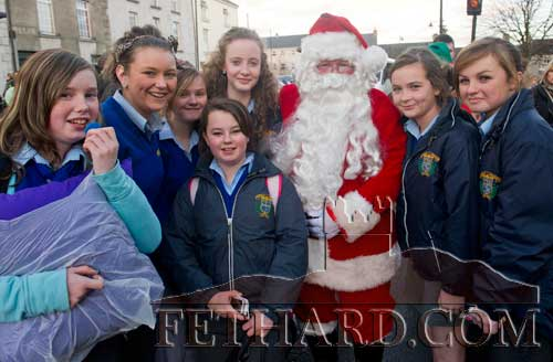 Santa photographed with pupils from Patrician Presentation Secondary School while on his visit to Fethard