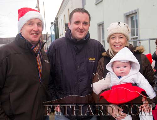 L to R: P.J. Ahearn, Gerry Ahearn, Leslie Swift and baby Harry photographed at Santa's visit to Fethard