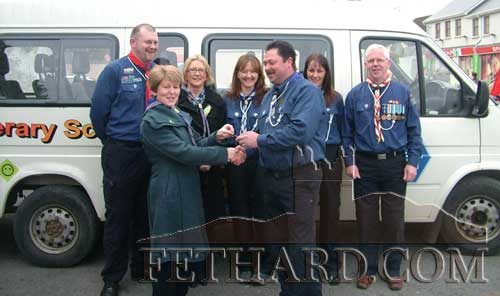 Tony Burgess photographed formally handing over the keys of a minibus to Mary Healy, chairman Fethard Scouts