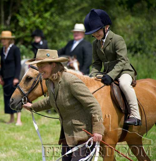 Taking part in Class 42 Equitation Lead-Rein at Killusty Pony SHow is A. Smurfit's 'Trigger' ridden by Ben Everard.