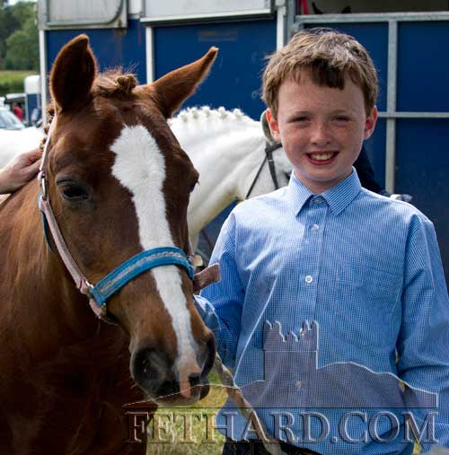 Peter Wall photographed with his pony at Killusty Pony Show