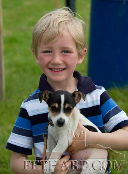 Tobyn Lawless, Cloneen, with his puppy at Killusty Pony Show