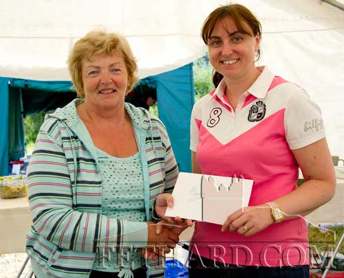 Lorraine Thompson, secretary Killusty Pony Show, making a presentation to Bernie Byrne (left) to mark her long years service at catering for the Killusty Pony Show.