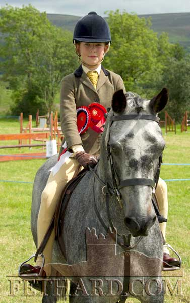 Amy McNamara on 'Phoenix Molloy', Champion in the Working Hunter Class at Killusty Pony Show