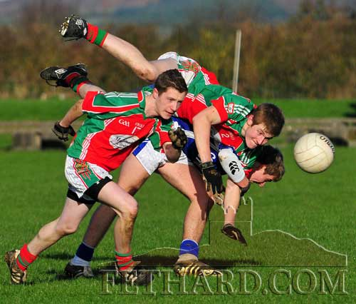In the U21 B South Semi Final on Saturday 26th February, Mullinahone's David Waltzer chases down a breaking ball, while his team-mate George Browning attempts a less orthodox route past Fethard's Eoin Fitzgerald. (Photo by Kieran Butler)