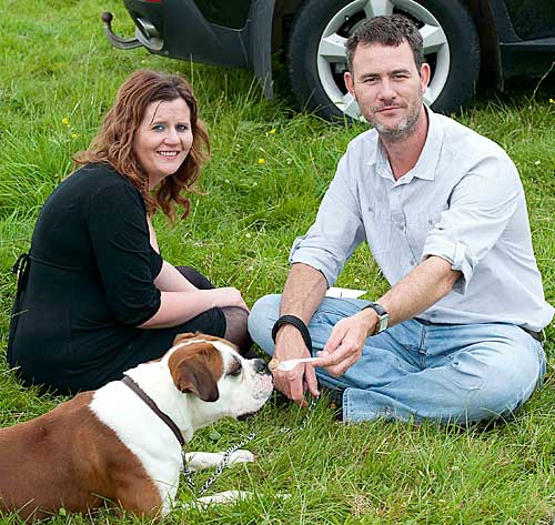 Carol and Mylo McCormack with their dog Tango enjoying the good weather at Moyglass Vintage Day