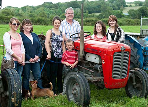 Photographed at Moyglass Vintage Day are L to R: Vikie Damon, Betty Kennedy, Kelly-Ann Nevin, Jake Dorney,  Jimmy Egan, owner of 1959 Massey 35, Patricia Kennedy and Michelle O'Donnell
