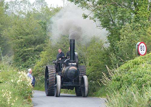 This is the 1911 Fowler Steam engine, owned by the Crosse family of Donaskeigh entering Moyglass Village