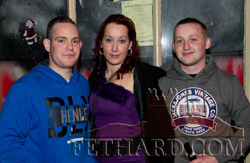 Enjoying New Year's Eve in the Castle Inn are L to R: J.J. Lalor, Amelia Stokes and Brendan Stokes.
