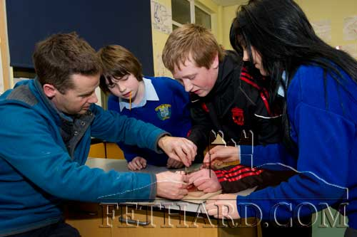 Science teacher, Mr Noel Maher, showing students how to dissect a heart at the Open Evening at Fethard Patrician Presentation Secondary School