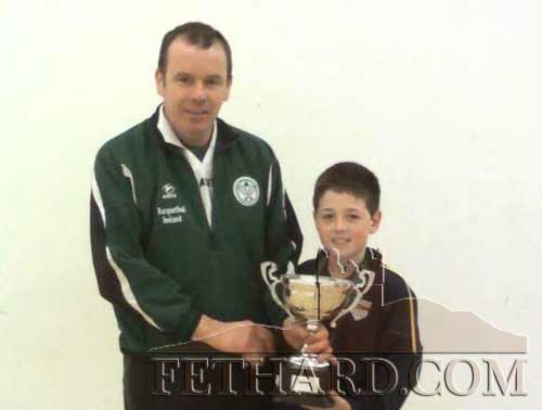 Josh Nevin presented with his trophy after winning his first All Ireland Racquetball title