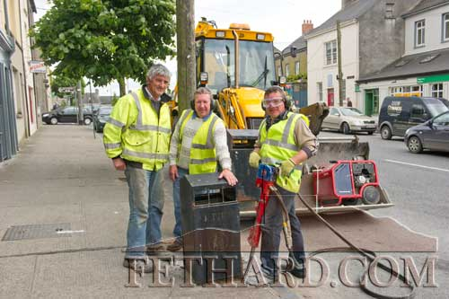 County Council workers removing litter bins for the Queen's visit