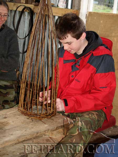 students from Patrician Presentation Secondary School on a visit to basket makers Patsy Cahill and Jane Walker