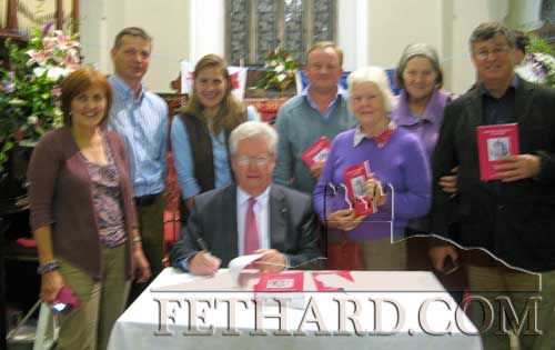Gerard Crotty signing his book for members of the Everard family L to R: Michelle and Paude Everard, Clonmel; Lady Nicola and Sir Harry Everard, Kilsheelan; Lady Ariel Everard, Norfolk, England; and Mary and Tom Everard, Templetouhy.