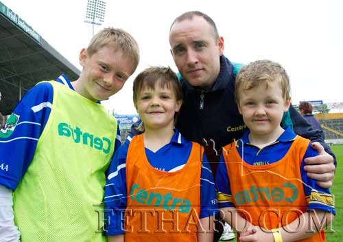 Photographed with Tipperary hurling star, Eoin Kelly, are L to R: Cathal Ryan and Oisín Ryan from Fethard, Eoin Kelly and Senan Ryan (Newport), at the Centra Brighten up Your Day Community Event at Semple Stadium on Saturday 2nd June. The free family event featured two of Centra's GAA Hurling Ambassadors, Eoin Kelly (Tipperary) and John Mullane (Waterford) who both hosted a hurling skills session for children. In addition, there was some cracking family fun, including face painting, a hurling skills simulator and a delicious BBQ by local Centra retailers, Cussen's (Centra) Bansha, Ryan's (Centra) Newport, Butler's (Centra) Dundrum, O'Connell's (Centra) Templemore, Ryan's (Centra) Cappawhite.    Centra, Ireland's largest convenience retailer who is in its third year as sponsor of the GAA Hurling All Ireland Championship will be spreading the GAA message with top inter-county players across local communities throughout Ireland. The Centra 'Brighten Up Your Day' Community Events will take place every Saturday until July 28th.   For more information log onto www.centra.ie or Facebook.com/centraireland