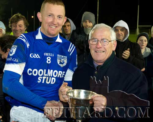 Tipperary County GAA Board chairman Sean Nugent presents Fethard captain PJ Aherne with the cup following Fethard's 0-17 to 1-5 win over Moycarkey in the Junior B County Final on Saturday, November 24.