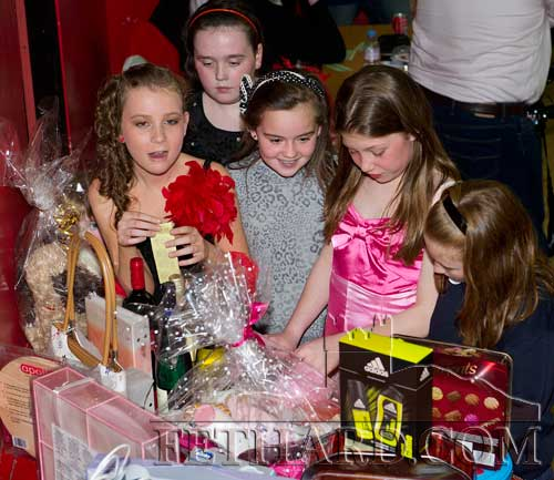 Children admiring the prizes sponsored by Fethard Car Boot Sale at Holy Trinity National School's 'Strictly Come Dancing' competition in aid of Fethard Day Care Centre held at Fethard Ballroom