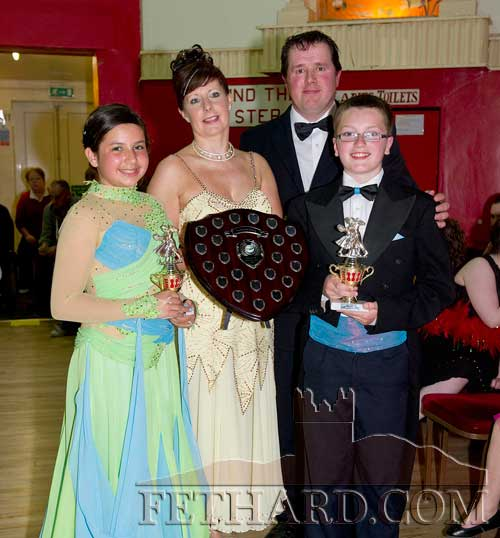 Winners of this year's Under-14 'Strictly Come Dancing' competition at Fethard Ballroom, Roisín McDonnell and Harry Butler, receiving their trophies from co-ordinators, Tom Delaney and Marina Mullins.