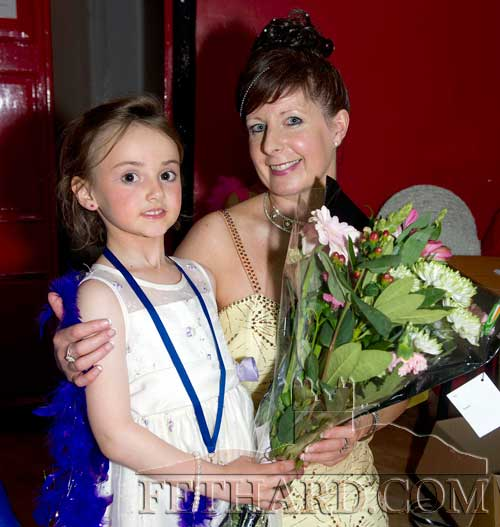 Aine Connolly presenting competition organiser, Marina Mullins, with a bouquet of flowers.