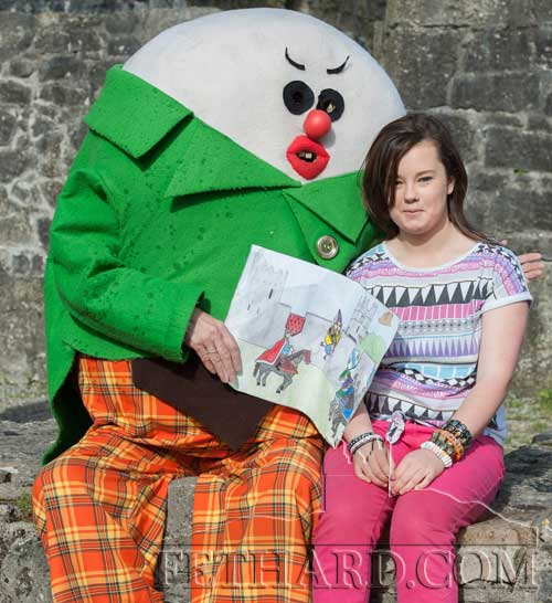 Humpty Dumpty presenting Cassie Needham with 1st Prize in the Medieval Festival Art Competition, 14 to 18 year olds.