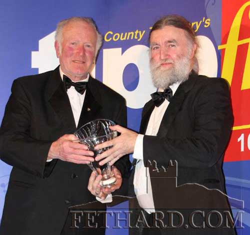 Fethard photographer Joe Kenny (right), the August monthly winner at the Tipp FM Art & Entertainment Annual Awards, photographed receiving his award from board member, William Fitzpatrick, at the Awards Ceremony Ball held in Dundrum House Hotel on Friday 20th January. Joe was honoured for his excellent photography skills, as well as his involvement in many aspects of life in his native Fethard: a former member of Fethard Players, editor of the Annual Emigrants' Newsletter, and founder member of the Fethard Historical Society.