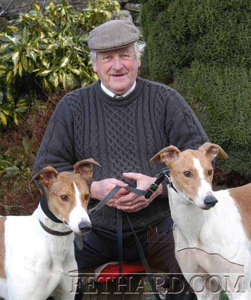 The late Billy Morrissey, Tullamaine, photographed with his two Derby Qualifiers for Clonmel National Coursing week 2004.  On the left is 'Fiodh Árd' and on the right is, 'Call Me Major'.