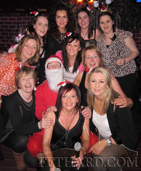 Colm McGrath photographed with his Bootcamp participants at their Christmas Party held in Lonergan's Bar.