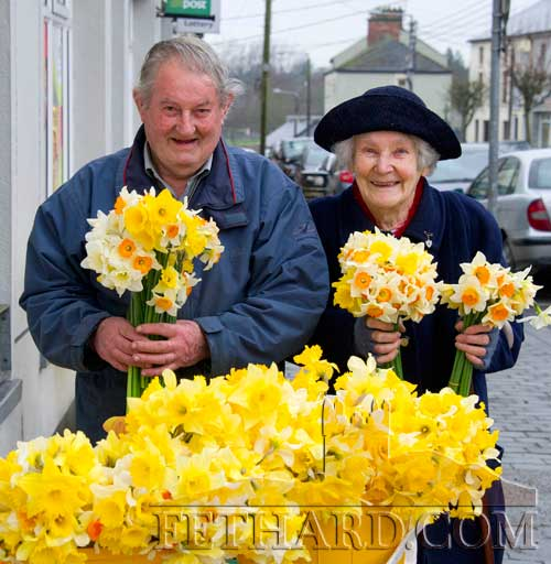 Fethard Country Market members, Christy Williams and Hannie Leahy, taking a break to buy some daffodils outside the Post Office in Fethard