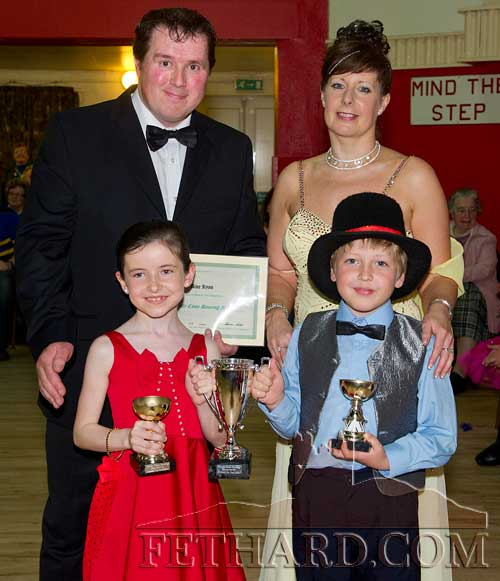 Winners of this year's Under-10 'Strictly Come Dancing' competition at Fethard Ballroom, Aine Ryan and Oleg Novikova receiving their trophies from co-ordinators, Tom Delaney and Marina Mullins.