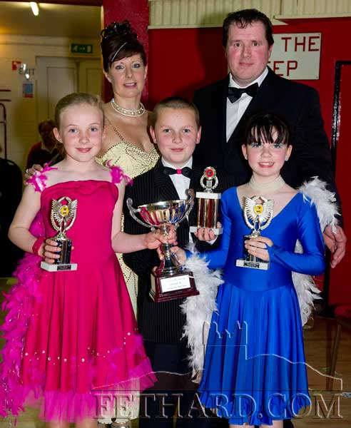 Winners of this year's Under-12 'Strictly Come Dancing' competition at Fethard Ballroom, Emma Jayne Burke, Ben Murphy and Megan Hackett, receiving their trophies from co-ordinators, Tom Delaney and Marina Mullins.