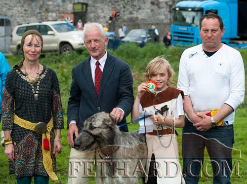 Richard Robinson and his Irish Wolfhound who was winner in the Fethard Medieval Dog Show. L to R: organisers Catherine Kearney, Pat Culligan, Richard Robinson (winner) and Ian Meagher (prize sponsor)