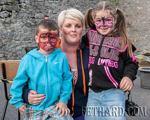 Photographed at the 'Fire Walk' in Fethard are Susan McCormack with Katie and Ben Allen