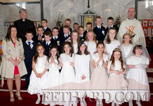 Fethard boys and girls who received their First Holy Communion last weekend photographed with their teacher Ms Sarah Hogan, Canon Tom Breen P.P. and Fr. Anthony McSweeney.